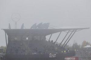 Rain falls around the circuit