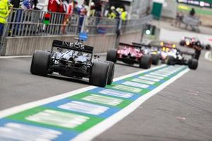 Lewis Hamilton, Mercedes F1 W11, leaves the pit lane