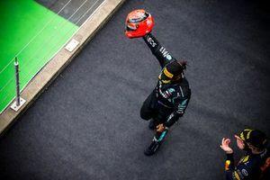 Lewis Hamilton, Mercedes-AMG Petronas F1, 1st position, on the podium with the helmet of Michael Schumacher