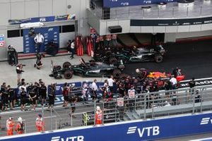 Pole man Lewis Hamilton, Mercedes F1 W11, Max Verstappen, Red Bull Racing RB16, and Valtteri Bottas, Mercedes F1 W11, arrive in Parc Ferme after Qualifying