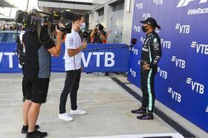 Pole man Lewis Hamilton, Mercedes-AMG F1, is interviewed by Stoffel Vandoorne