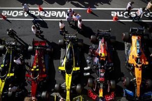 The cars of Esteban Ocon, Renault F1 Team R.S.20, Charles Leclerc, Ferrari SF1000, Daniel Ricciardo, Renault F1 Team R.S.20, Alex Albon, Red Bull Racing RB16, and Carlos Sainz Jr., McLaren MCL35, in Parc Ferme after Qualifying