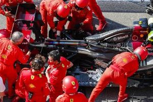 Ferrari mechanics at work on the grid