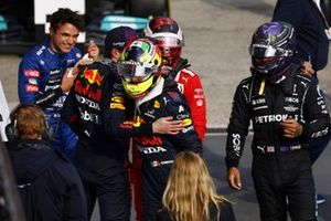 Sergio Perez, Red Bull Racing, congratulates race winner Max Verstappen, Red Bull Racing, as Lewis Hamilton, Mercedes, looks on