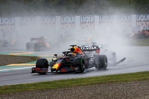 Bodywork flies as Max Verstappen, Red Bull Racing RB16B, battles with Lewis Hamilton, Mercedes W12, at the start