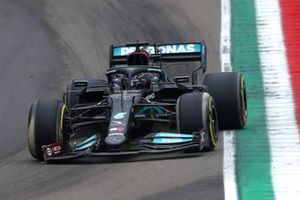 Lewis Hamilton, Mercedes W12, heads to the pits with a broken front wing