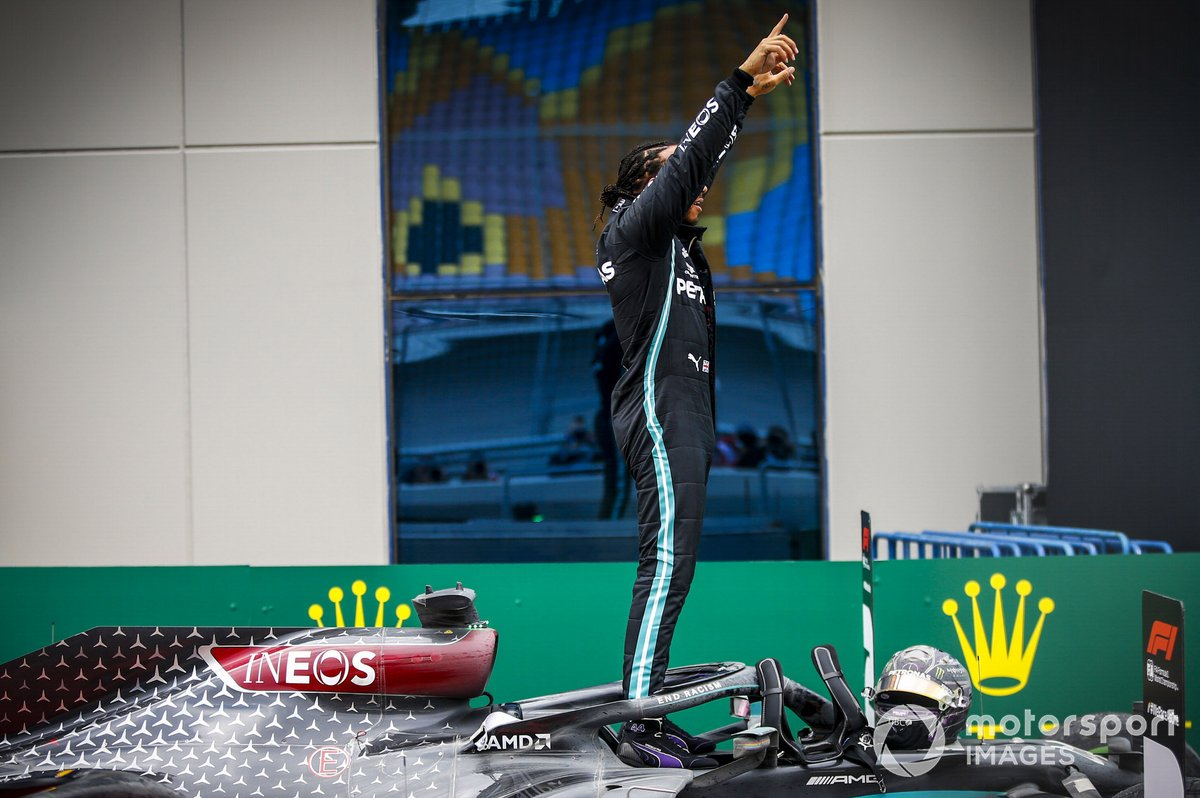 Lewis Hamilton, Mercedes-AMG F1, climbs out of his car after winning the race, to take his 7th World Championship title