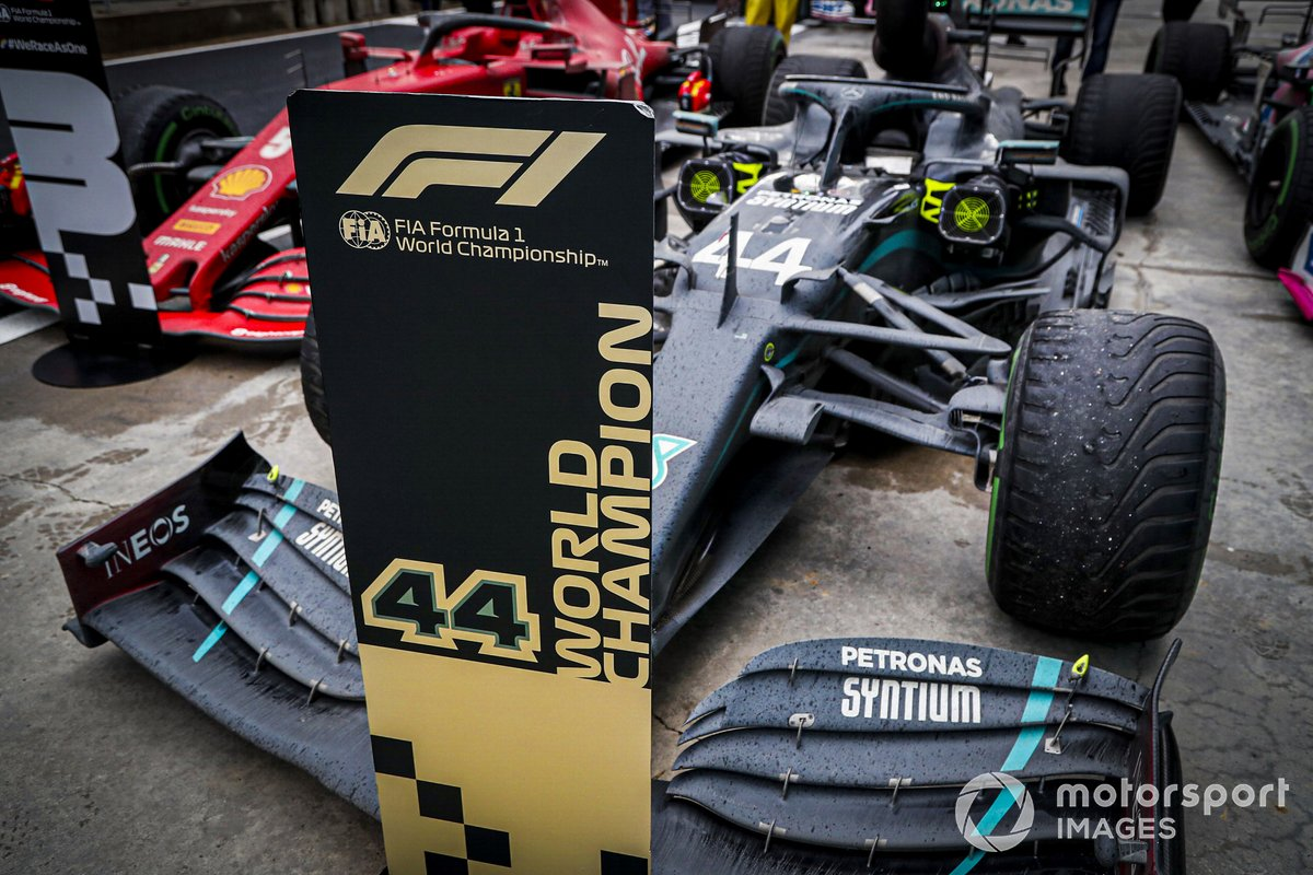 The car of Lewis Hamilton, Mercedes F1 W11, 1st position, in Parc Ferme Lewis Hamilton, Mercedes-AMG F1, climbs out of his car after winning the race, to take his 7th World Championship title