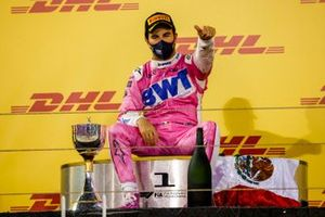 Sergio Perez, Racing Point, 1st position, takes a seat on the podium