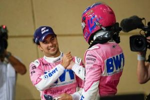Sergio Perez, Racing Point, 1st position, and Lance Stroll, Racing Point, 3rd position, congratulate each other in Parc Ferme