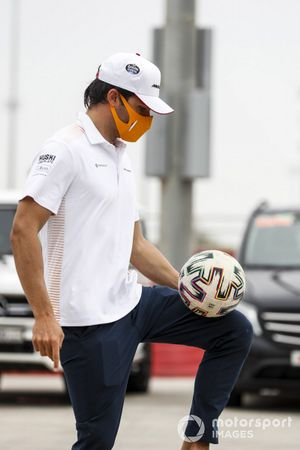 Carlos Sainz Jr., McLaren playing with a football in the paddock