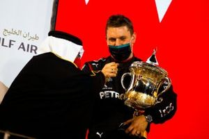 The Mercedes delegate receives the Constructors trophy on behalf of the team