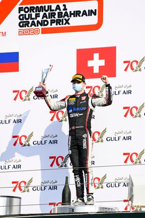 Louis Deletraz, Charouz Racing System celebrates ont he podium with the trophy