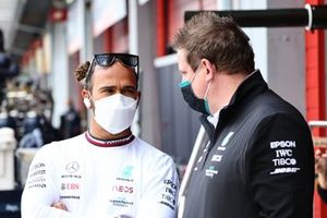 Lewis Hamilton, Mercedes, speaks with a member of the team