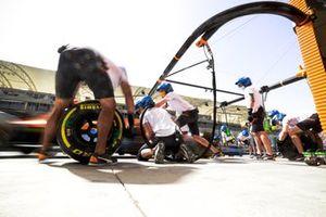 Pit stop practice outside the McLaren garage