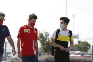 Charles Leclerc, Ferrari talks to Guanyu Zhou, Renault Sport Academy driver