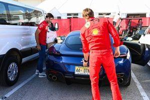 Carlos Sainz Jr., Ferrari, exits a Ferrari Roma