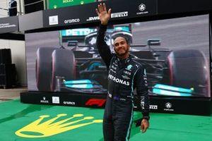 Pole man Lewis Hamilton, Mercedes, waves from Parc Ferme