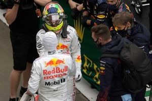 Max Verstappen, Red Bull Racing, 2nd position, and Sergio Perez, Red Bull Racing, 3rd position, celebrate in Parc Ferme