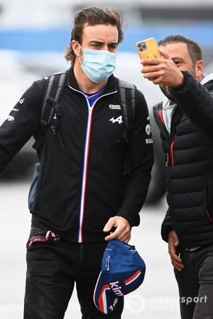 Fernando Alonso, Alpine F1 poses for a selfie as he arrives at the track