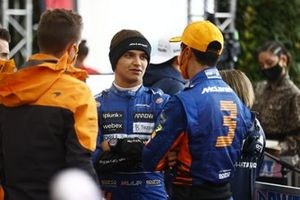 Lando Norris, McLaren, and Daniel Ricciardo, McLaren, talk after the race