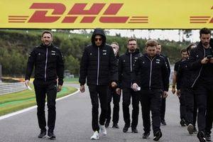 Esteban Ocon, Alpine F1, walks the track with members of his team