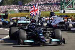 Lewis Hamilton, Mercedes W12, 1st position, arrives in Parc Ferme with a Union flag