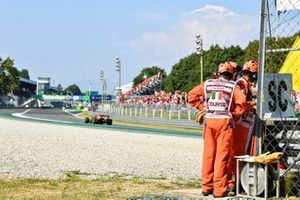 Sergio Perez, Red Bull Racing RB16B, passes a marshals post