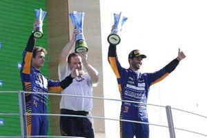 Lando Norris, McLaren, 2nd position, Zak Brown, CEO, McLaren Racing, and Daniel Ricciardo, McLaren, 1st position, with the trophies