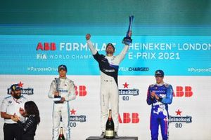 Jake Dennis, BMW I Andretti Motorsport, first position, lifts the winners trophy