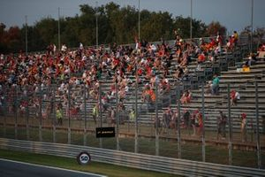 Fans spread out in a grandstand