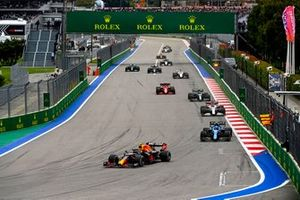 Sergio Perez, Red Bull Racing RB16B, Esteban Ocon, Alpine A521, and Kimi Raikkonen, Alfa Romeo Racing C41