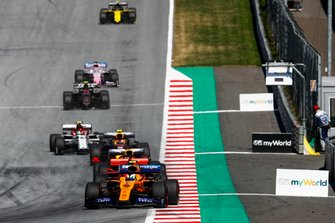 Lando Norris, McLaren MCL34, leads Sebastian Vettel, Ferrari SF90, Max Verstappen, Red Bull Racing RB15, Pierre Gasly, Red Bull Racing RB15, and Antonio Giovinazzi, Alfa Romeo Racing C38