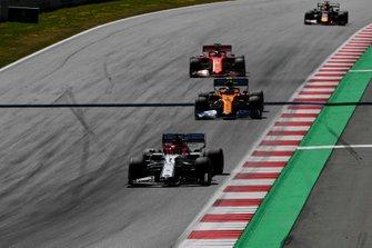 Kimi Raikkonen, Alfa Romeo Racing C38, leads Lando Norris, McLaren MCL34, Sebastian Vettel, Ferrari SF90, and Max Verstappen, Red Bull Racing RB15