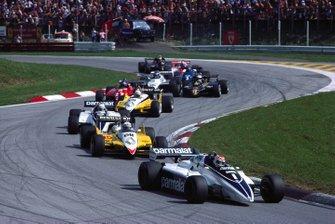 Nelson Piquet, Brabham BT50 BMW, leads Alain Prost, Renault RE30B