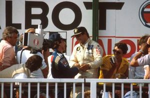 Podium: race winner Elio de Angelis, Lotus Ford congratulated by Keke Rosberg, Williams, 2nd position