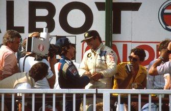 Podium: race winner Elio de Angelis, Lotus Ford congratulated by Keke Rosberg, Williams, 2nd position
