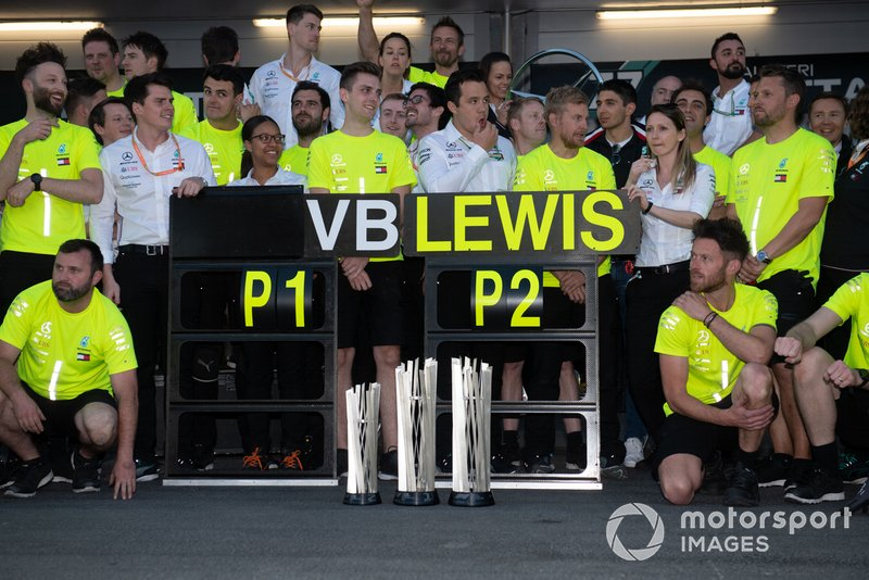 The Mercedes team celebrates a perfect weekend