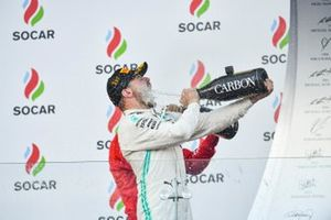 Valtteri Bottas, Mercedes AMG F1, 1st position, blasts himself with Champagne on the podium