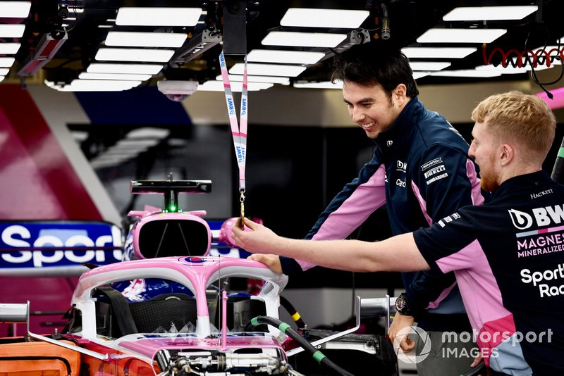 Sergio Perez, Racing Point RP19 looking at a medal above his car
