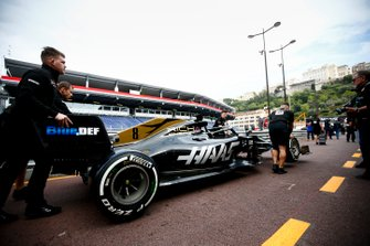Car of Romain Grosjean, Haas F1 Team VF-19 being pushed down the pit lane my Haas F1 mechanics
