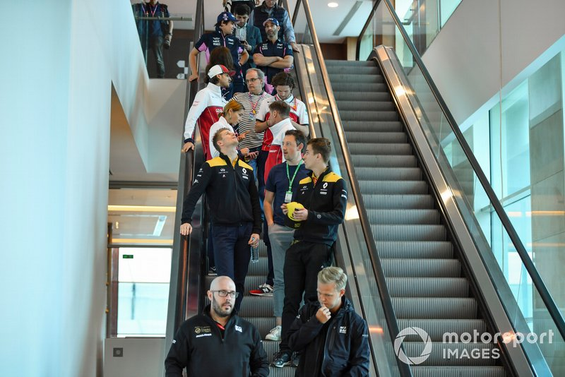 Kevin Magnussen, Haas F1, Nico Hulkenberg, Renault F1 Team, Antonio Giovinazzi, Alfa Romeo Racing and Lance Stroll, Racing Point RP19 on an escalator
