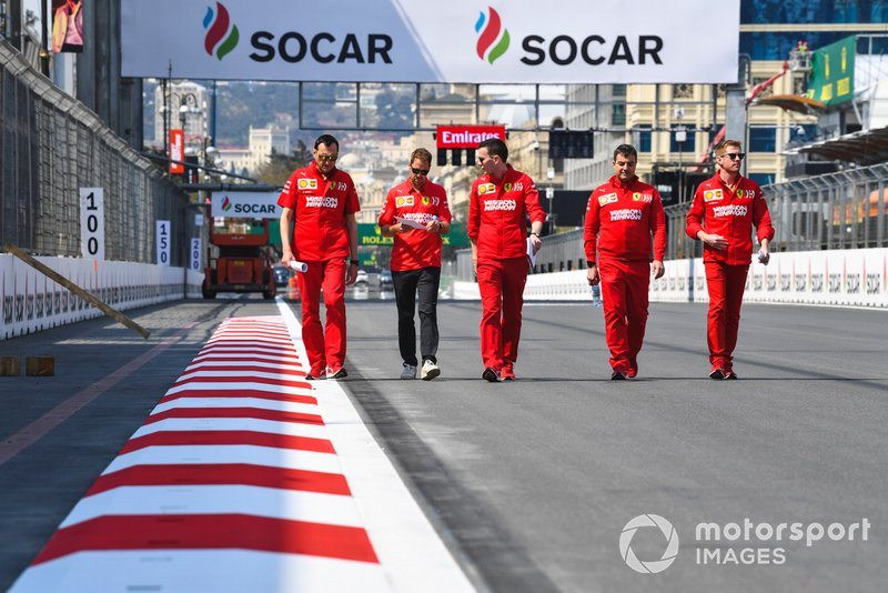 Sebastian Vettel, Ferrari walks the track with his engineers