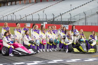 The drivers pose for a pre-season photo on the grid