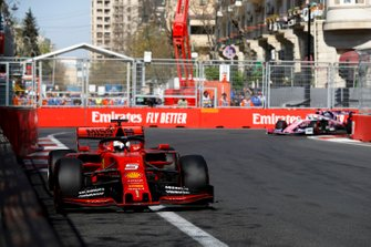 Sebastian Vettel, Ferrari SF90, leads Sergio Perez, Racing Point RP19