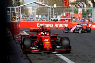 Sebastian Vettel, Ferrari SF90 and Sergio Perez, Racing Point RP19