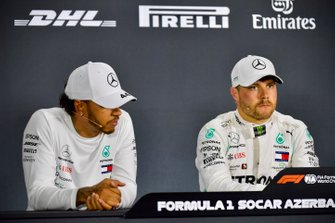 Front row starters, Lewis Hamilton, Mercedes AMG F1, and pole man Valtteri Bottas, Mercedes AMG F1, in the post Qualifying Press Conference