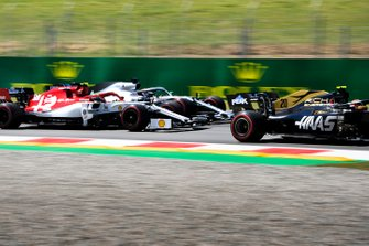 Kevin Magnussen, Haas F1 Team VF-19, leads Antonio Giovinazzi, Alfa Romeo Racing C38, and Lewis Hamilton, Mercedes AMG F1 W10