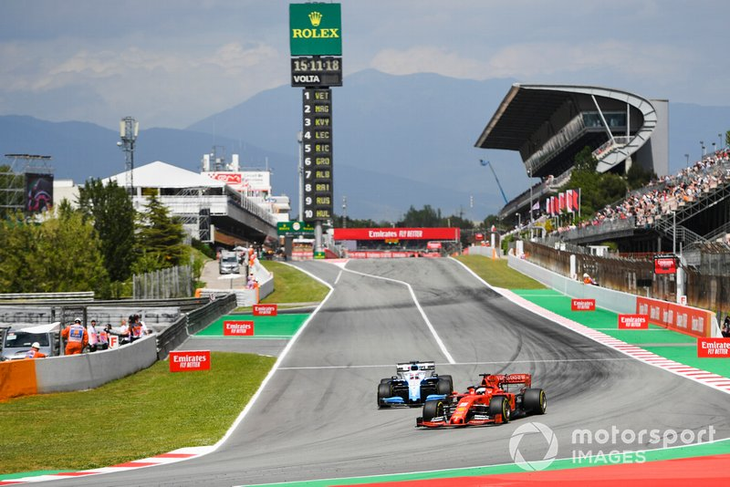 Sebastian Vettel, Ferrari SF90, leads George Russell, Williams Racing FW42