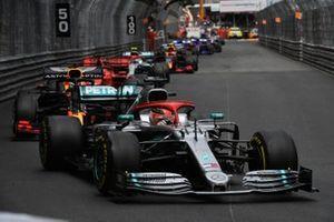 Lewis Hamilton, Mercedes AMG F1 W10, leads Max Verstappen, Red Bull Racing RB15, Sebastian Vettel, Ferrari SF90, Valtteri Bottas, Mercedes AMG W10, and the rest of the field